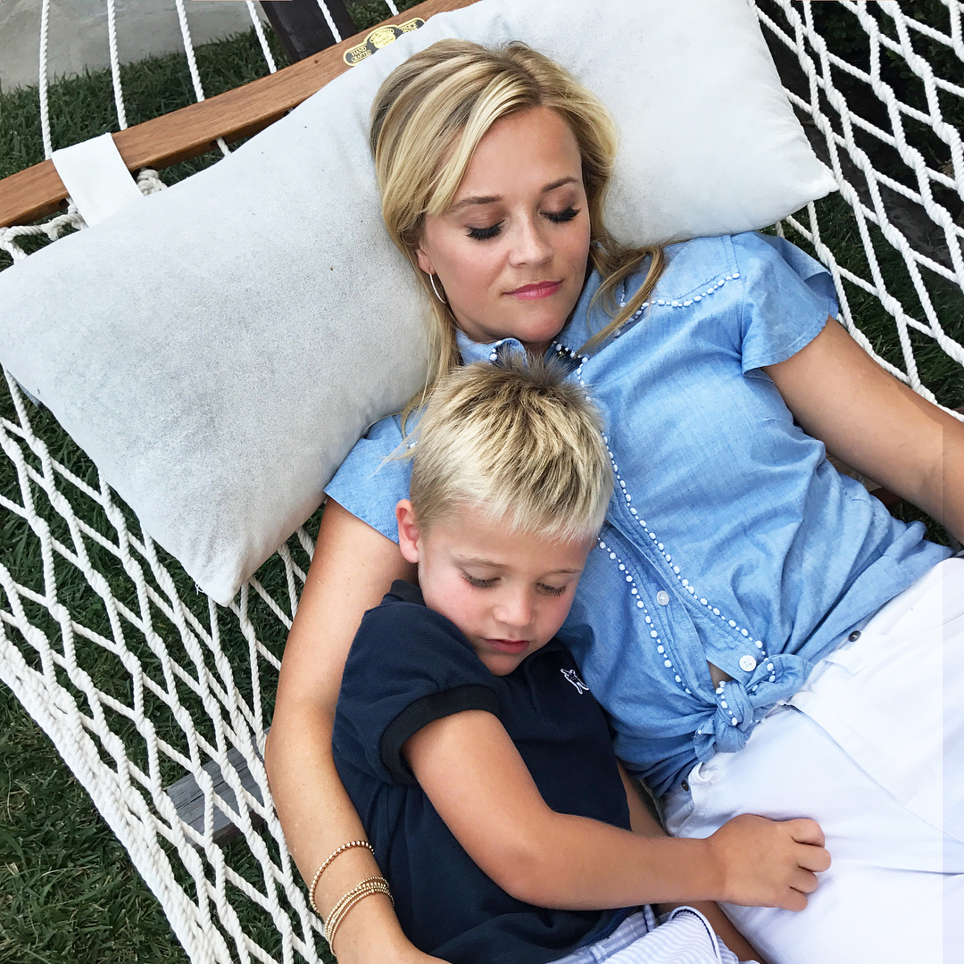 reese witherspoon snuggles with her son tennessee in new